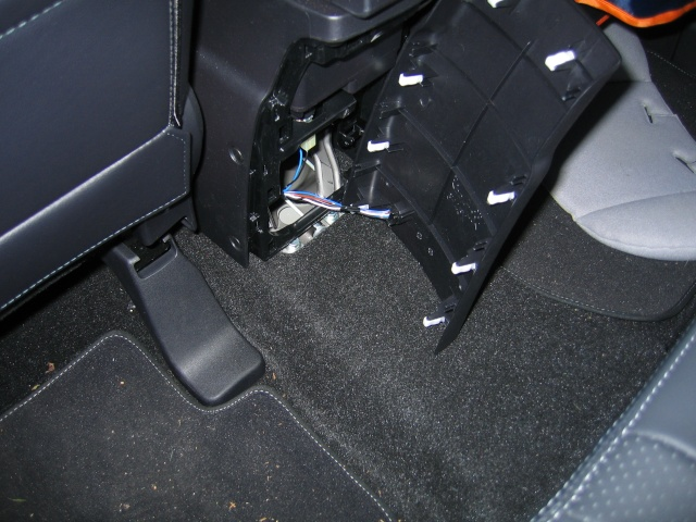 aux input rca connectors are on the bottom of the central armrest sometimes mitsubishi didnt installed rca sockets and on back side of armrest panel is